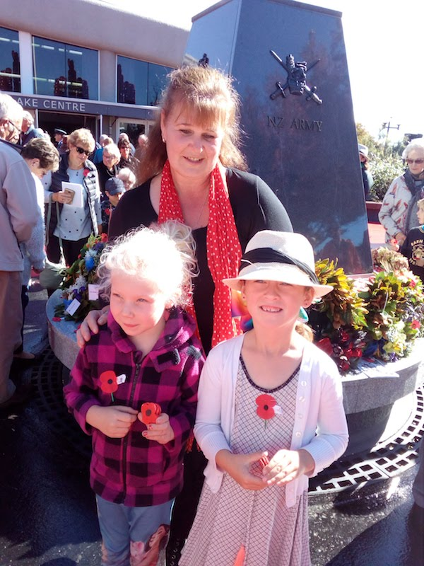9. At ANZAC service laying our poppies