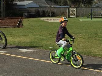 Joseph practicing his bike skills so he will be ready to ride on the pump track